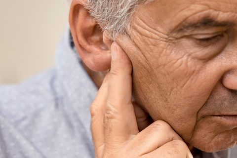 senior-man-with-hearing-problems-68VZQH2